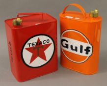 Two oil cans. The largest 33 cm high.