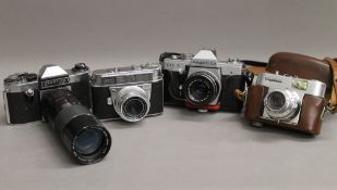 A collection of vintage cameras, including Voigtlander, etc.
