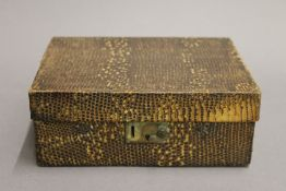 An early 20th century snake skin vanity case. 20.5 cm wide.