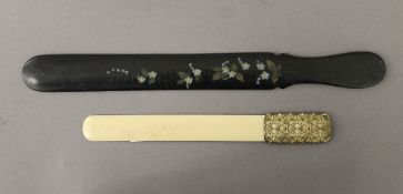 A Victorian painted papier mache page turner and another. The former 33.5 cm long.