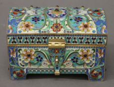 An enamel and cabochon decorated silver gilt casket, bearing Russian marks. 12 cm wide. 16.