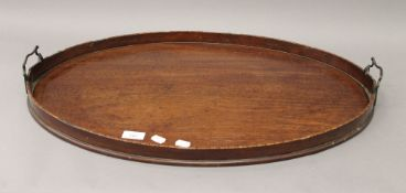 A 19th century mahogany tray. 69 cm wide.