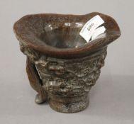 A libation cup. 12 cm high.