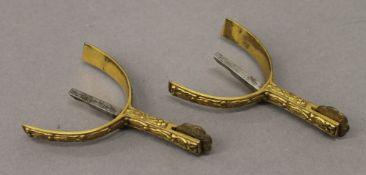 A box pair of gilt bronze spurs.