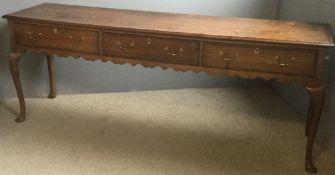 An 18th century oak low dresser. 204 cm wide, 51 cm deep, 81.5 cm high.