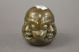 A bronze four faced buddha head. 11 cm high.
