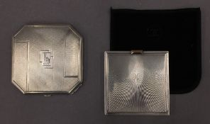 An Art Deco silver compact and another silver compact. The former 6.5 cm wide.