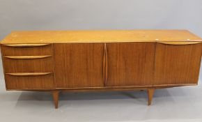 A mid-20th century sideboard. 201 cm long.
