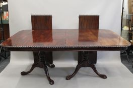 A 19th century style dining table, with two additional leaves. 278 cm long extended. 116 cm wide.