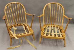 A pair of blonde Ercol lounge chairs. 70 cm wide.