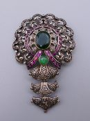 A vintage silver and gold mounted emerald, diamond and ruby pendant. 7.5 cm high. 21.