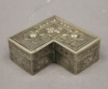 A Chinese white metal box. 10 cm wide.