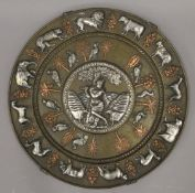 A Hindu unmarked silver, copper and bronze charger. 40 cm diameter.