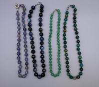 An agate facet cut bead necklace, a jade bead necklace and two others. The former 45 cm long.
