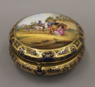 A Dresden painted porcelain box. 18 cm diameter.