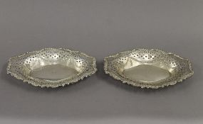 A pair of pierced silver bon bon dishes. Each 21 cm wide. 6.1 troy ounces.