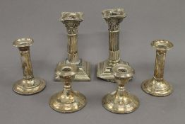 Three small pairs of silver candlesticks. The largest 15.5 cm high. 46.7 troy ounces weighted.