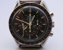 A gentleman's Omega Speedmaster Professional wristwatch, mounted on Tissot strap,