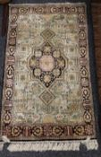 A Persian silk prayer rug. 140 x 79 cm.