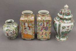 A Chinese vase with six character mark to base; a pair of Chinese vases of square form,