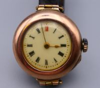 A ladies 9 ct gold cased wristwatch. 3 cm wide. 20 grammes total weight.