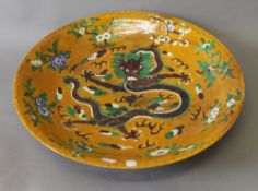 A large Chinese porcelain dish decorated with a dragon. 45 cm diameter.
