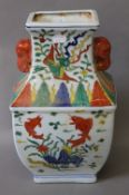 A Chinese porcelain vase decorated with fish. 36 cm high.
