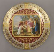 A 19th century Vienna gilt heightened and painted porcelain plate,