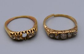 Two unmarked gold five stone diamond rings (one lacking a stone, the other shank has split).