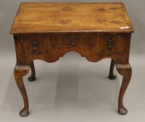 An 18th/19th century walnut lowboy. 71.5 cm wide.