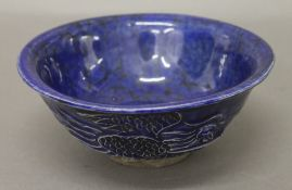 A Chinese blue ground pottery bowl. 15 cm diameter.