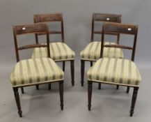 A set of four 19th century mahogany dining chairs. 48 cm wide.