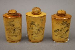 Three Chinese carved bone snuff bottles depicting erotic scenes. The largest 8.5 cm high.