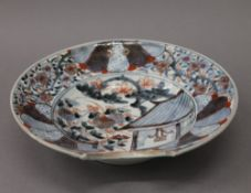 An early 18th century Japanese Imari barbers bowl of typical decoration and palette. 27.