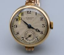 A ladies 9 ct gold cased J W Benson of London wristwatch, with a 9 ct gold J W Benson strap,