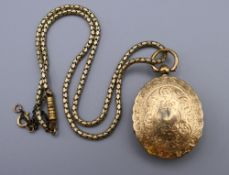 A Victorian unmarked gold locket (17 grammes total weight) on an associated plated chain.