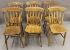 A set of six Victorian elm seated splat back kitchen chairs. 37 cm wide.
