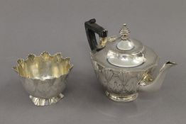 A Victorian silver sugar bowl (3.2 troy ounces) with matching unmarked white metal teapot.
