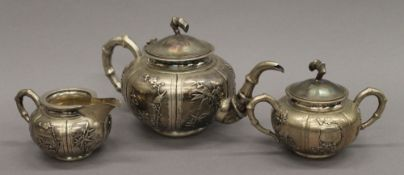 A Chinese silver three-piece tea set. The teapot 25 cm long. 30.1 troy ounces.