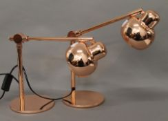A pair of copper adjustable lamps. 38 cm high.
