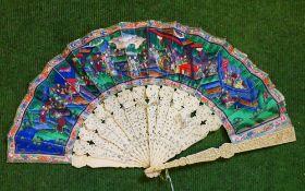 A 19th century Canton ivory fan. 27.5 cm high.