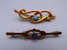 An unmarked gold turquoise set brooch and a 9 ct gold brooch. The former 4 cm wide. 3.