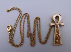 An Egyptian Ankh pendant on chain. The pendant 3.5 cm high.