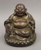 A seated bronze model of Buddha. 16 cm high.