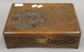 An early 20th century Oriental carved wooden box.