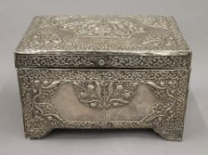 An 18th/19th century Eastern, probably Persian unmarked silver clad casket. 25 cm wide.