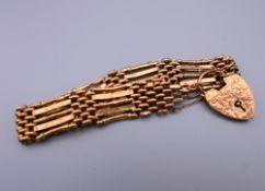 A 9 ct gold gate bracelet. 19 cm long. 16.7 grammes.