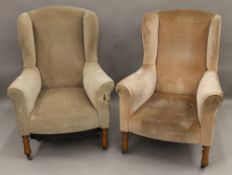 A pair of Edwardian wing back armchairs. 78 cm wide.