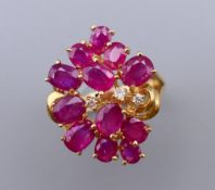 A 14 ct gold, diamond and ruby ring. Ring size N. 5.2 grammes total weight.