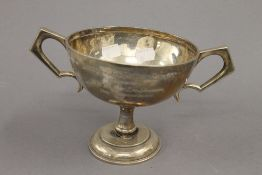 An engraved silver trophy cup. 13 cm high. 11.5 troy ounces.
